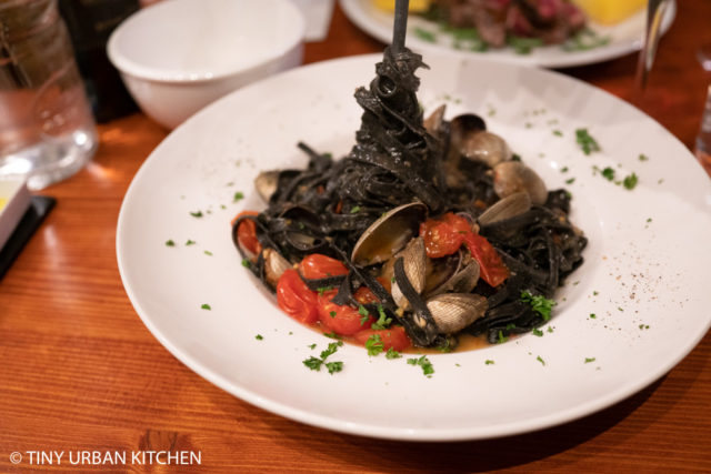 Winehouse Osteria Brussels squid ink pasta with clams and tomatoes